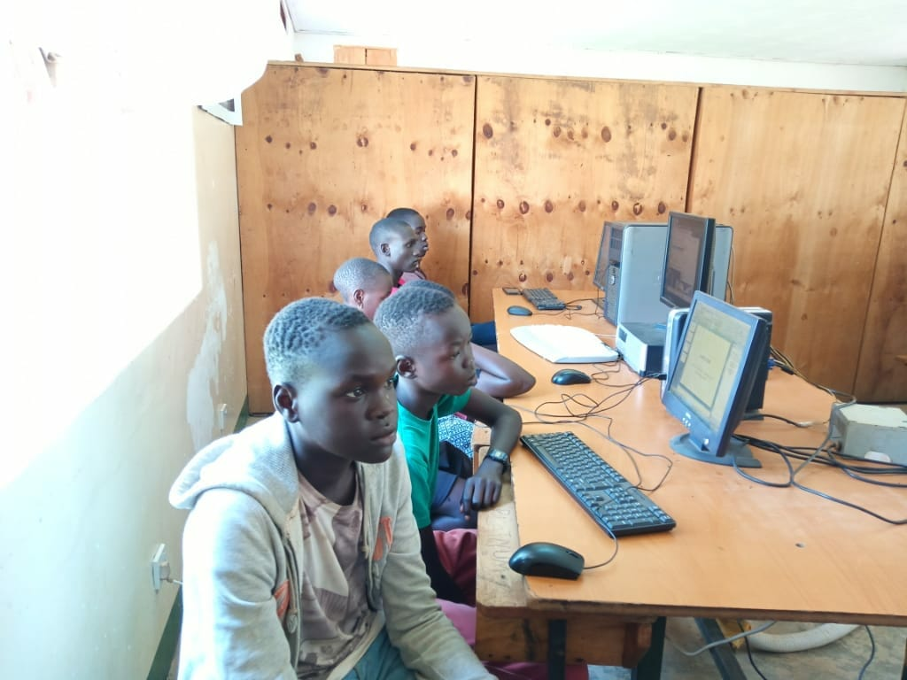 Picture of young boys at 5th Annual Community Outreach Computer Program