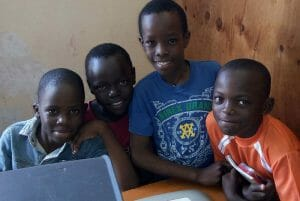 Young boys pose for picture during in DTML Computer lab in Luwero