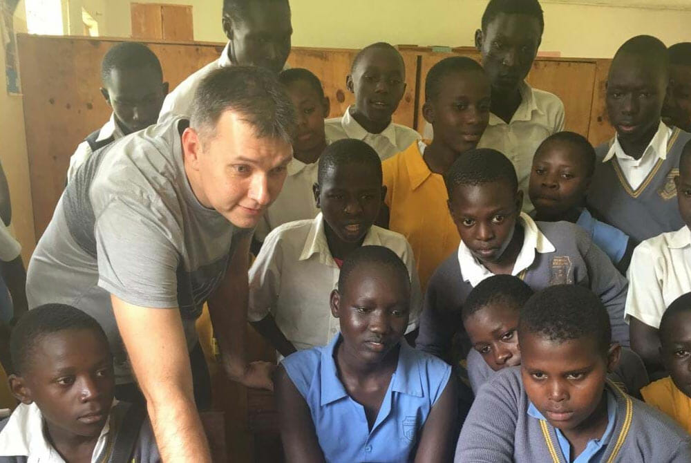 Aleksey showing the internet to young students in Ethiopia