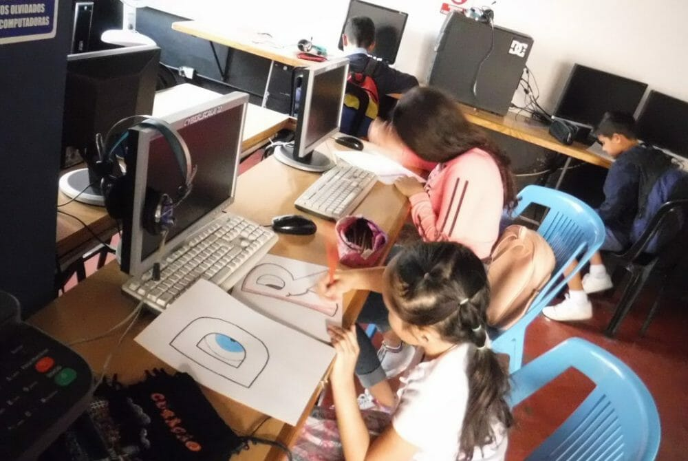 2020 Education Program - Kids with hands on assignment in school at JAAS