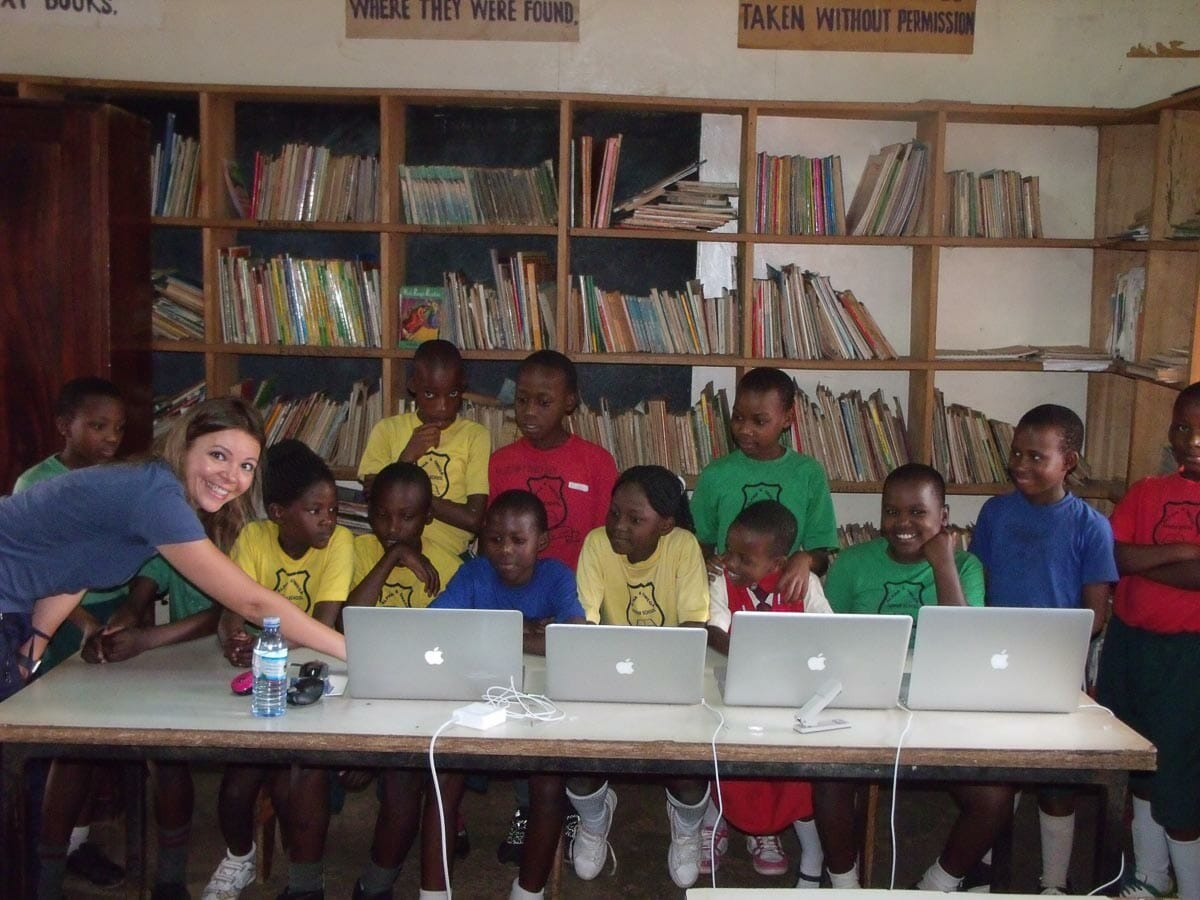 Close up of Jane Sinyagin with kids during computer outreach program