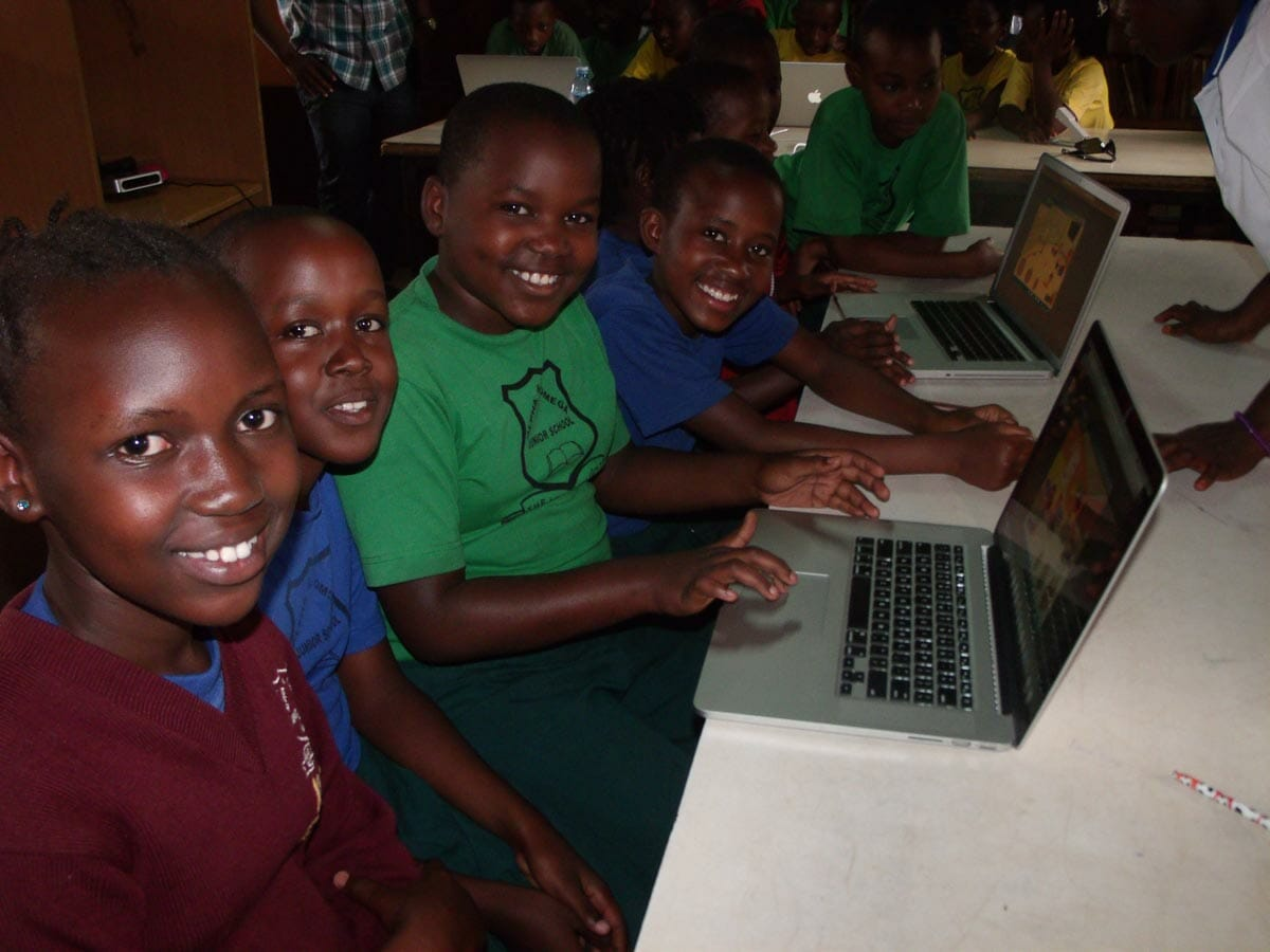 Close up of kids with new computer during computer outreach program
