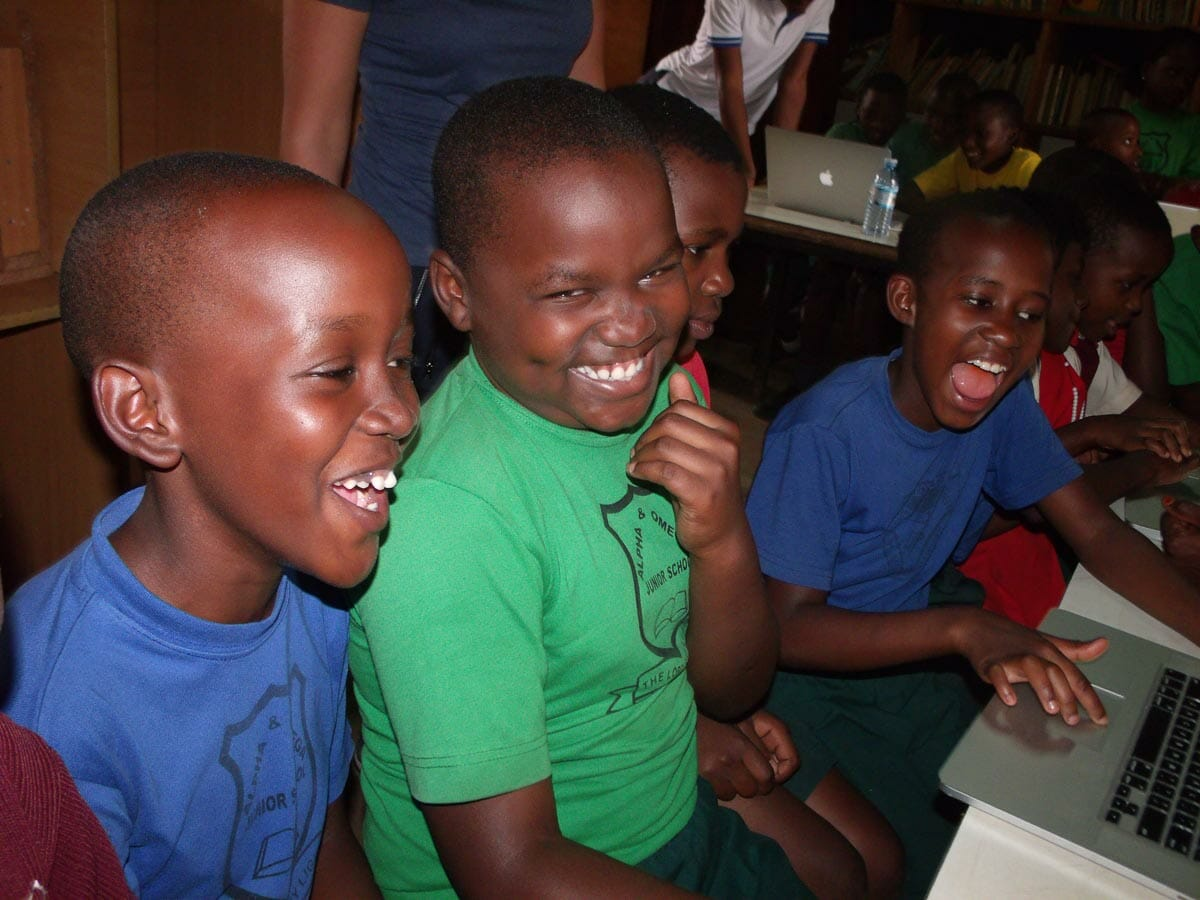 Close up of happy kids with new technology during event