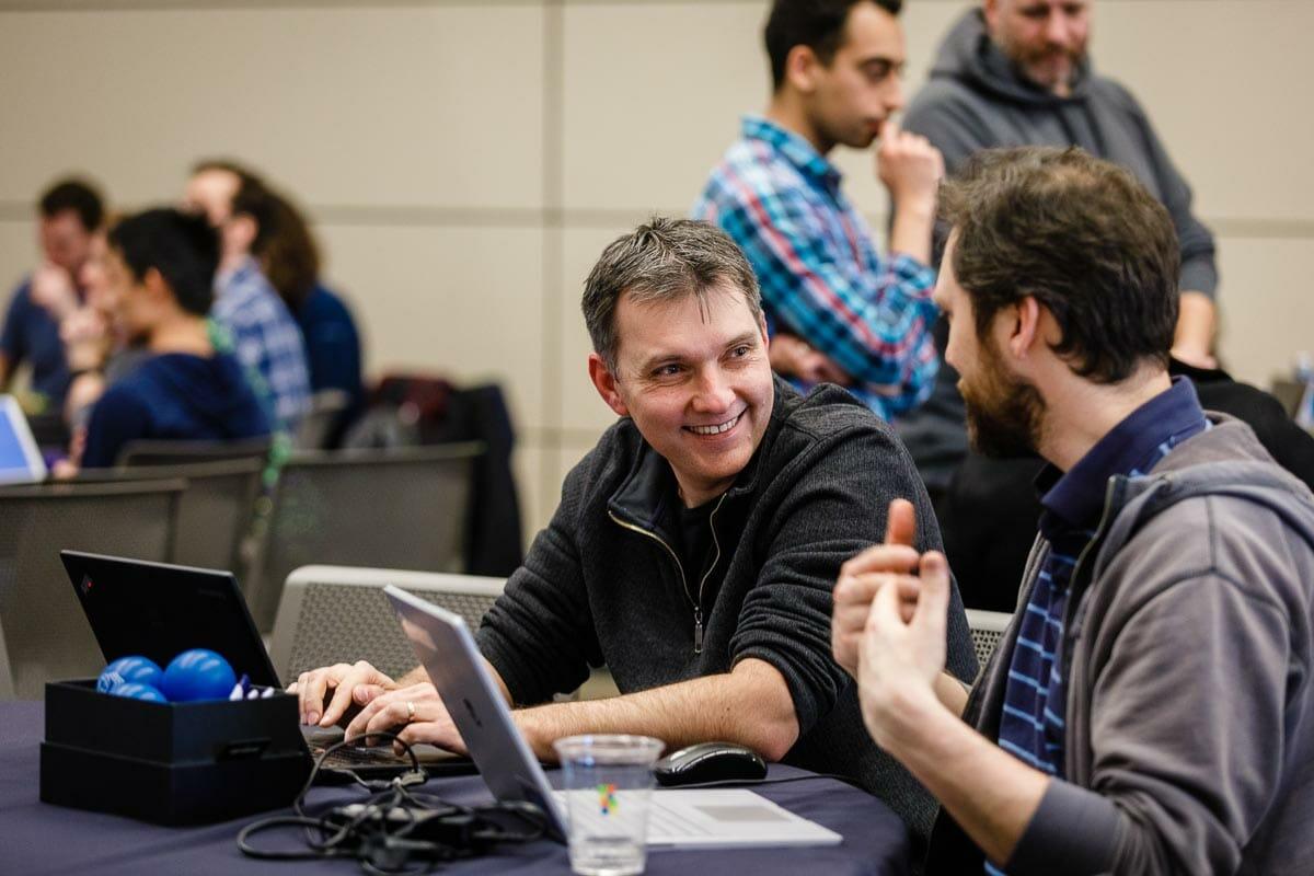 Dr. Aleksey Sinyagin during conversation at a Hackathon conference