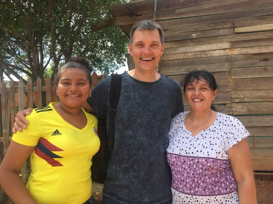 Dr Aleksey with local family during computer outreach