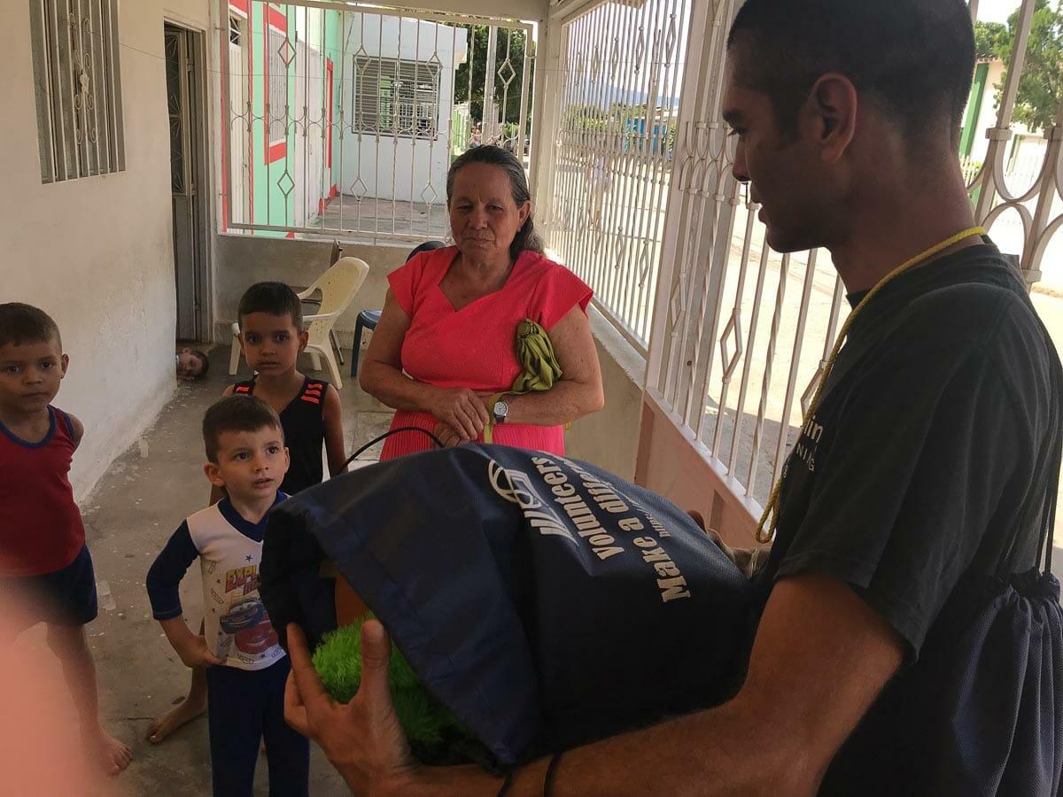 Nestor Jerez donating to families