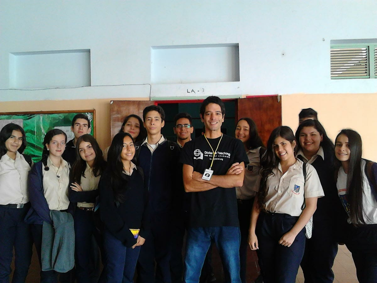 DTML Representative Nestor Jerez with a class of young learners
