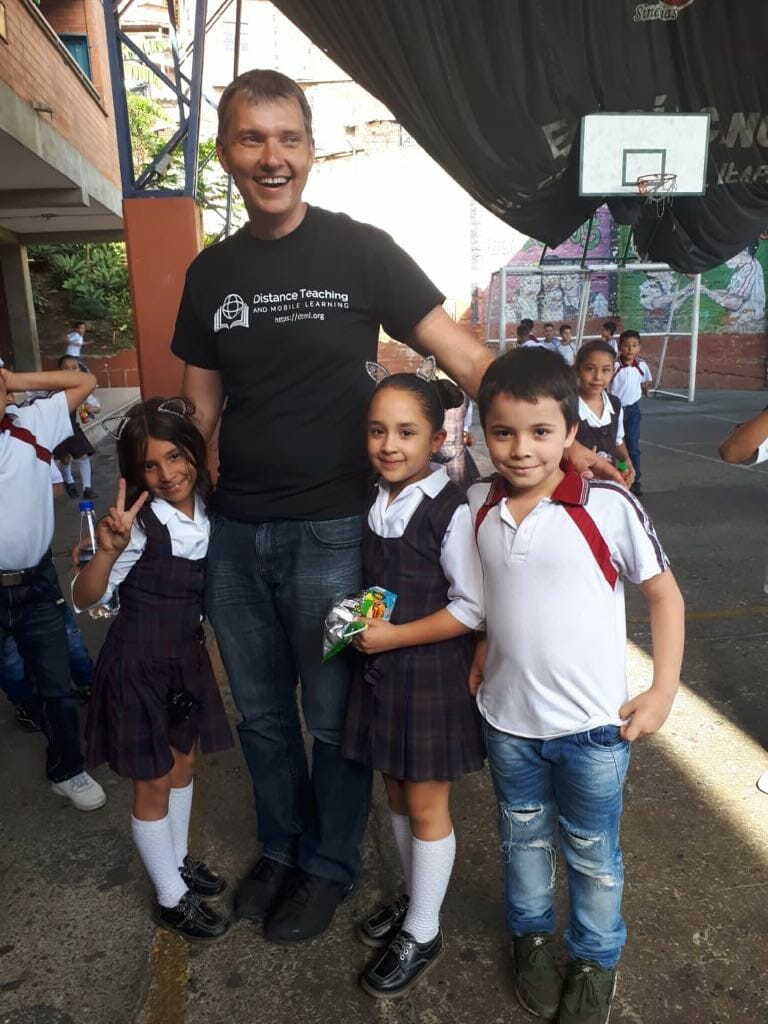 Dr Aleksey Sinyagin with kids at DTML event