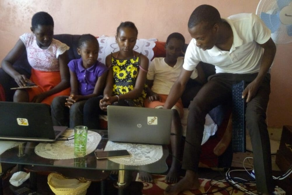 Picture of young kids with new technology from the JAAS Foundation