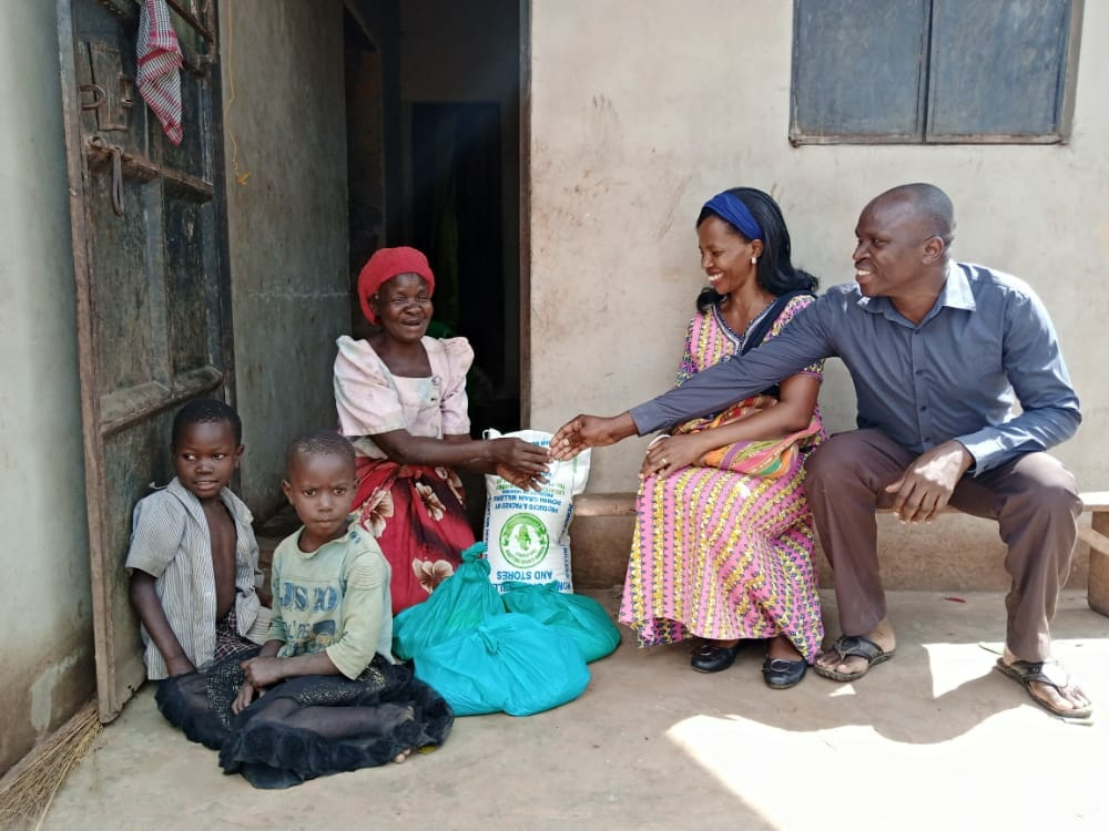 Smiling family with JAAS Foundation donations