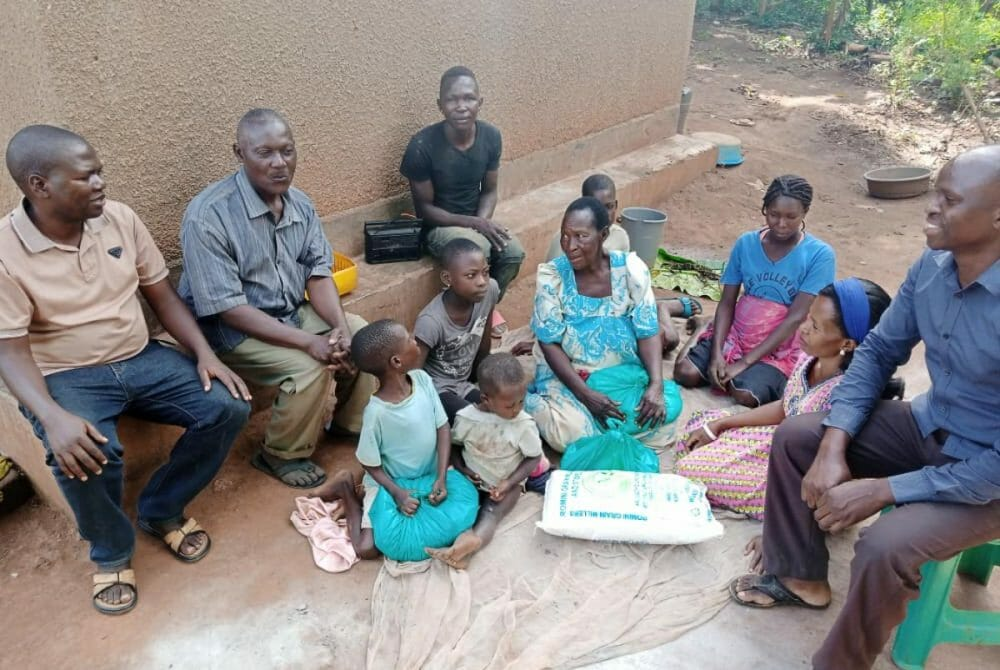 Picture of family sitting in Circle with a JAAS donation