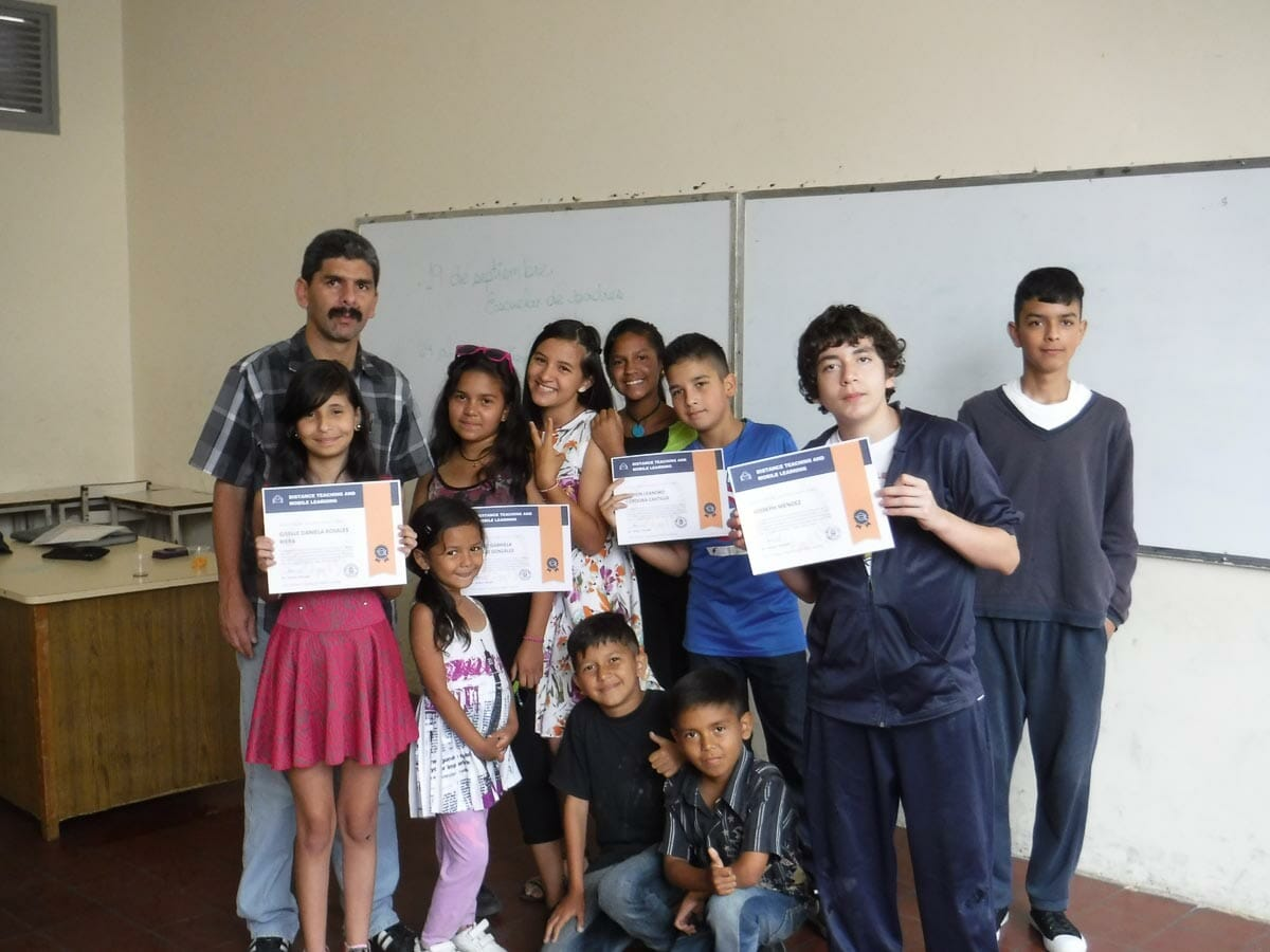 Class receiving certificate of achievement though the JAAS Foundation