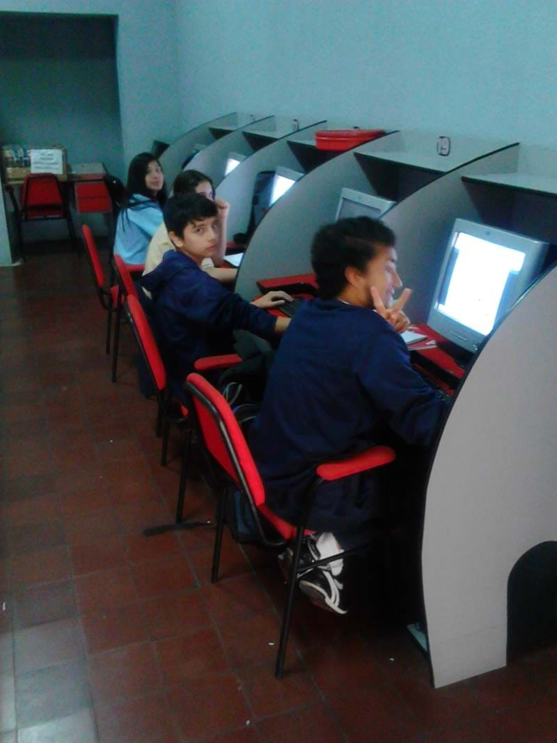 Picture of kids with new computer donations from the JAAS foundation