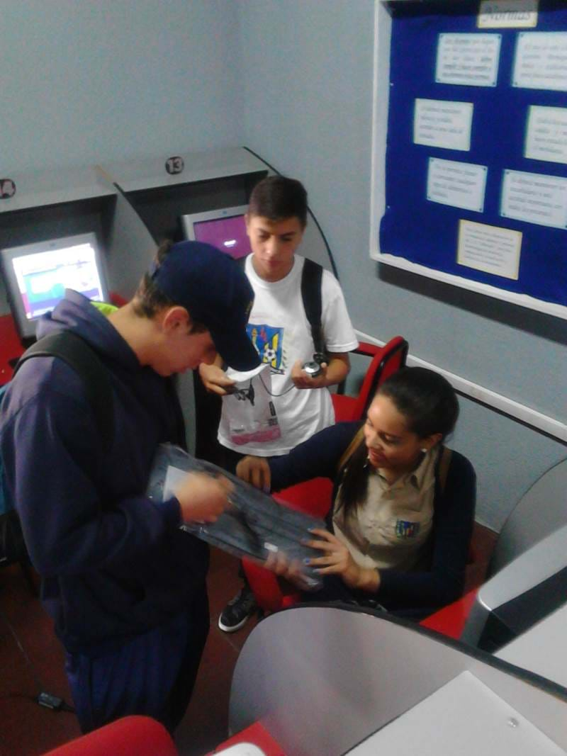 Picture of kids with new computer donations from JAAS