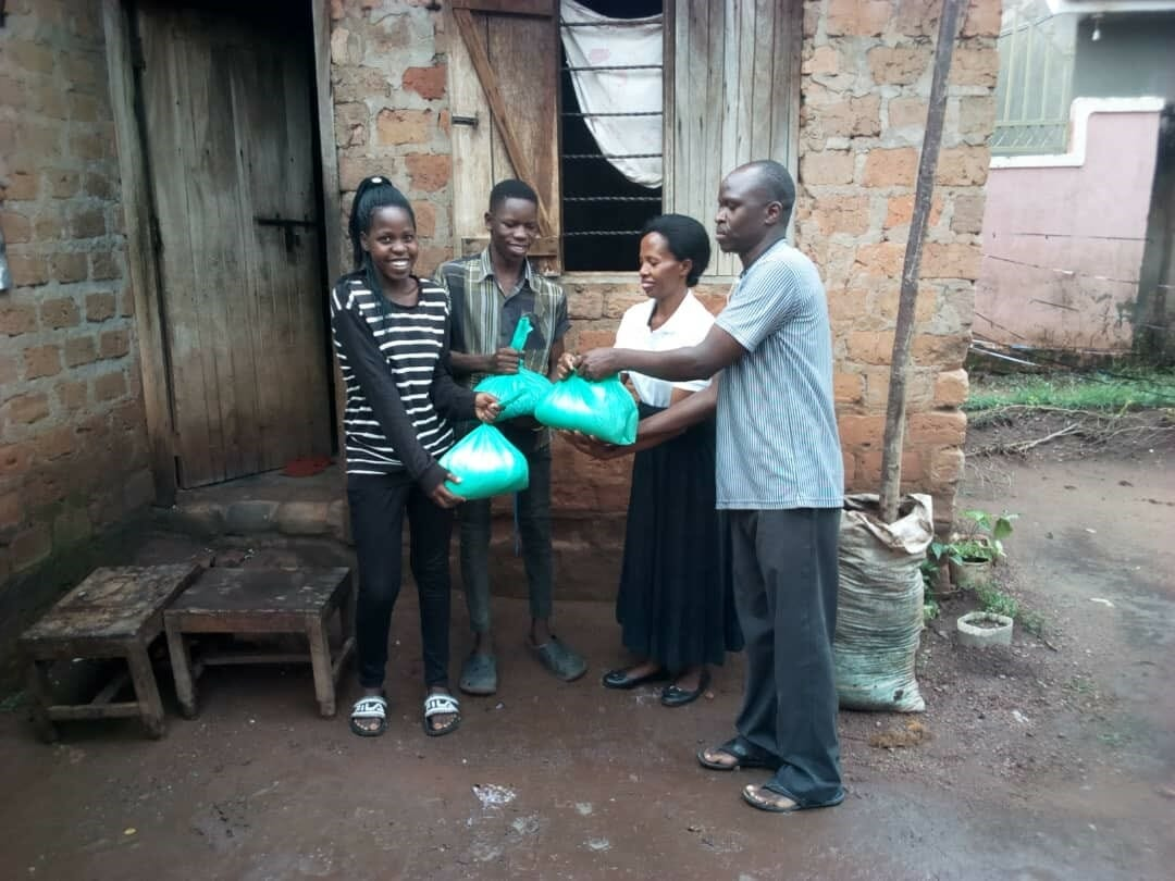 Family receiving food donation from JAAS Foundation